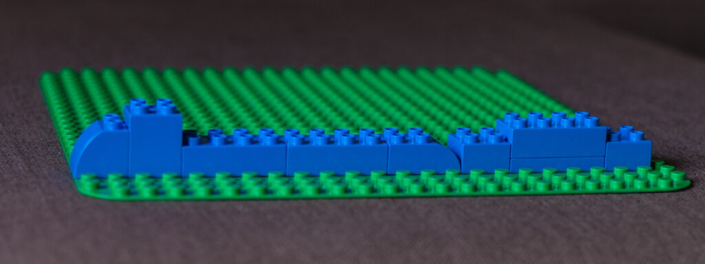 Blue legos forming a flat line.