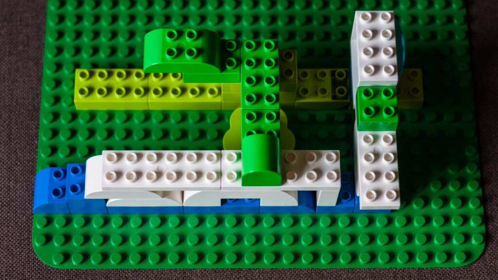 White and green lego lines connected by green and white bridges.